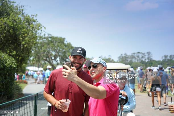 Jacksonville Jaguars quarterback Blake Bortles poses for a photo with a fan during the third round of THE PLAYERS Championship on THE PLAYERS Stadium...