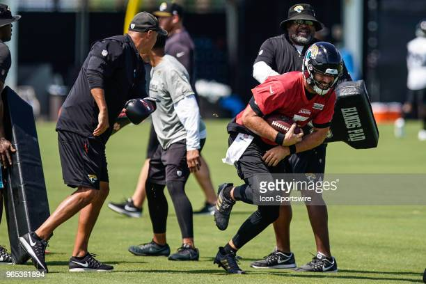 Jacksonville Jaguars quarterback Blake Bortles runs with the ball during a drill during the Jaguars OTA on June 1 2018 at Dream Finders Homes...
