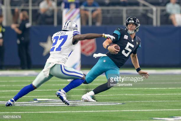 Jacksonville Jaguars quarterback Blake Bortles slides in front of Dallas Cowboys cornerback Jourdan Lewis during the game between the Jacksonville...