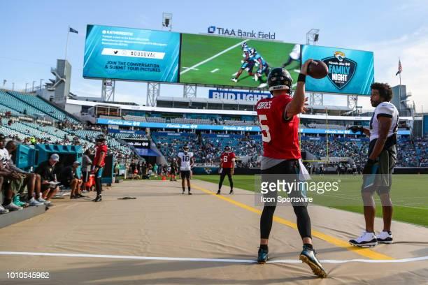 Jacksonville Jaguars quarterback Blake Bortles warms up on the sidelines with Jacksonville Jaguars tight end Austin SaferianJenkins Jacksonville...