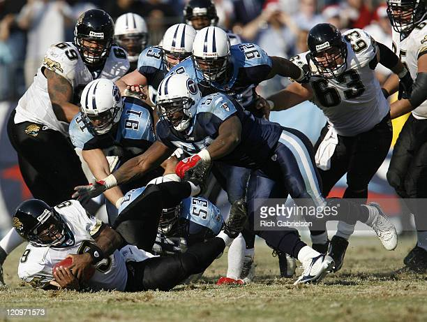 Jacksonville Jaguars quarterback David Garrard is met by the Tennessee Titans defense The Tennessee Titans defeated the Jacksonville Jaguars by a...