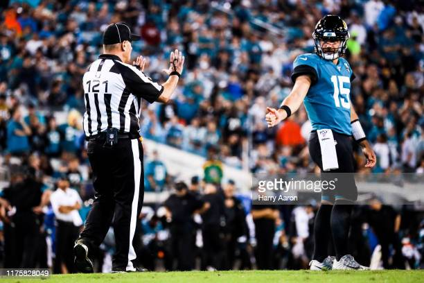 Jacksonville Jaguars quarterback Gardner Minshew II signals to an official in the second half against the Tennessee Titans at TIAA Bank Field on...