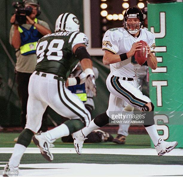 Jacksonville Jaguars' quarterback Mark Brunell gets chased out of the pocket by the New York Jets' Anthony Pleasant in the first quarter of their...