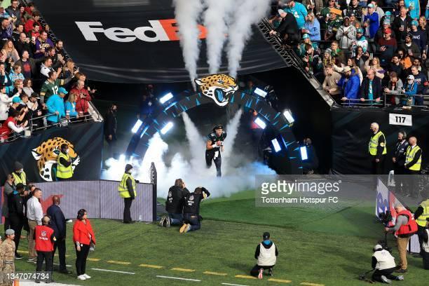 Jacksonville Jaguars' Quarterback Trevor Lawrence runs out during the NFL London 2021 match between Miami Dolphins and Jacksonville Jaguars at...