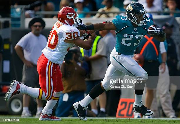 Jacksonville Jaguars Rashad Jennings runs 28yards for a touchdown as Kansas City Chiefs safety Mike Brown left defends on the play in firstquarter...