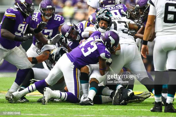 Jacksonville Jaguars running back Brandon Wilds is tackled by Minnesota Vikings outside linebacker Reshard Cliett in the 3rd quarter during the...