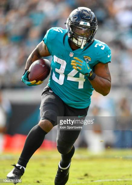 Jacksonville Jaguars running back Carlos Hyde carries the ball during the first half of an NFL game between the Pittsburgh Steelers and the...