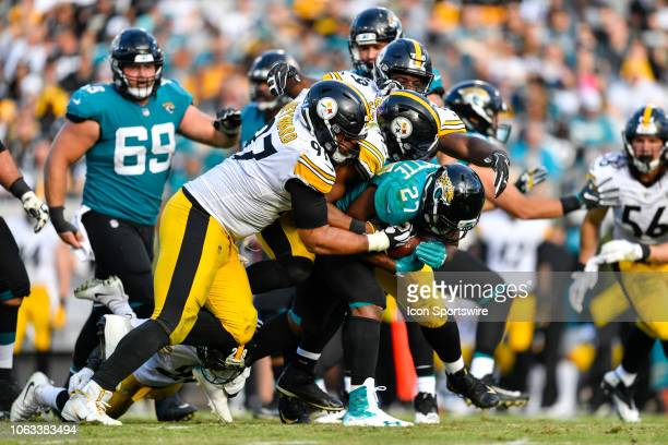 Jacksonville Jaguars running back Leonard Fournette carries defenders during the second half of an NFL game between the Pittsburgh Steelers and the...
