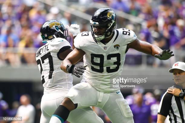 Jacksonville Jaguars running back Leonard Fournette left celebrates with defensive tackle Calais Campbell after Fournette scored a touchdown in the...