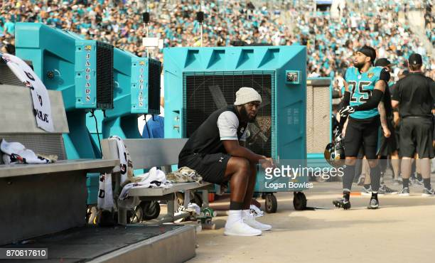 Jacksonville Jaguars running back Leonard Fournette sits on the bench after he was deactivated for Sunday's game against Cincinnati after he violated...