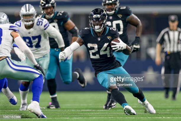 Jacksonville Jaguars running back TJ Yeldon carries the ball during the game between the Jacksonville Jaguars and Dallas Cowboys on October 14 2018...
