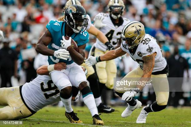 Jacksonville Jaguars running back TJ Yeldon is tackled by New Orleans Saints safety Kurt Coleman and New Orleans Saints defensive end Trey...