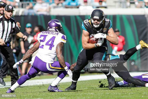 Jacksonville Jaguars Tight End Ben Koyack braces for a tackle by Minnesota Vikings Cornerback Captain Munnerlyn during the NFL game between the...