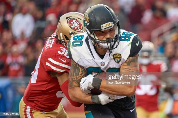 Jacksonville Jaguars tight end James O'Shaughnessy beats San Francisco 49ers defensive back Adrian Colbert to score a touchdown during an NFL game...