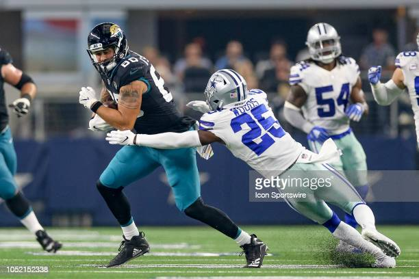 Jacksonville Jaguars tight end James O'Shaughnessy makes a catch with Dallas Cowboys free safety Xavier Woods defending during the game between the...