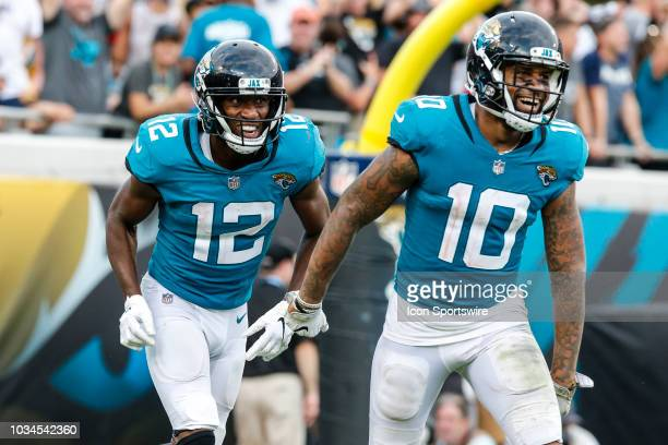 Jacksonville Jaguars wide receiver Dede Westbrook and Jacksonville Jaguars wide receiver Donte Moncrief celebrate a touchdown during the game between...