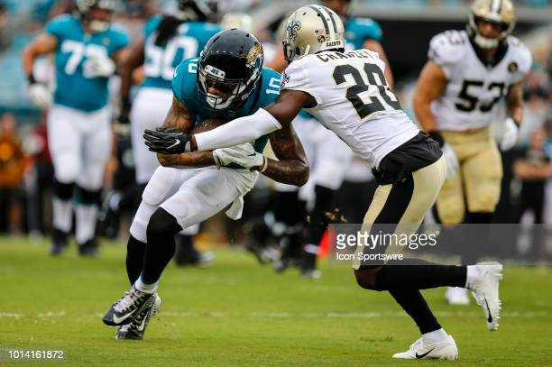 Jacksonville Jaguars wide receiver Donte Moncrief is tackled by New Orleans Saints cornerback Ken Crawley after a catch during the game between the...