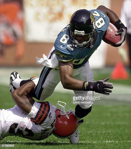 Jacksonville Jaguars' wide receiver Jimmy Smith is tackled by Cleveland Browns' cornerback Daylon McCutcheon during the third quarter on 03 September...