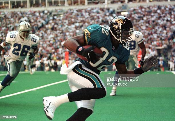 Jacksonville Jaguars wide receiver Jimmy Smith steps into the end zone for the Jaguars' first score in their game against the Dallas Cowboys at Texas...