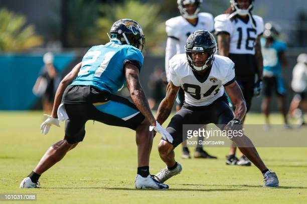 Jacksonville Jaguars wide receiver Keelan Cole jukes Jacksonville Jaguars cornerback AJ Buoye during the Jacksonville Jaguars Training Camp on August...