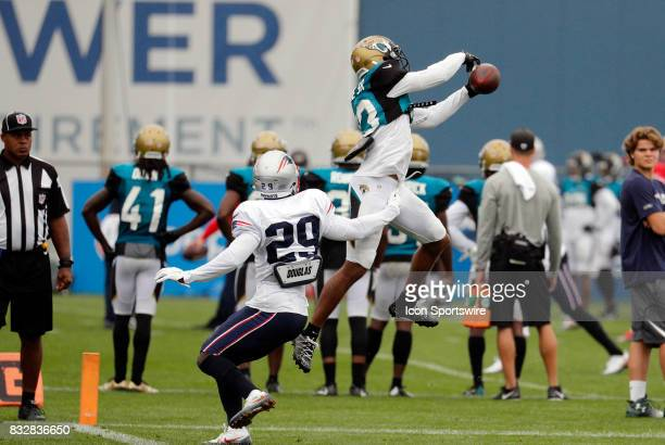 Jacksonville Jaguars wide receiver Rashad Greene Sr makes a catch over New England Patriots defensive back DJ Killings during a joint New England...