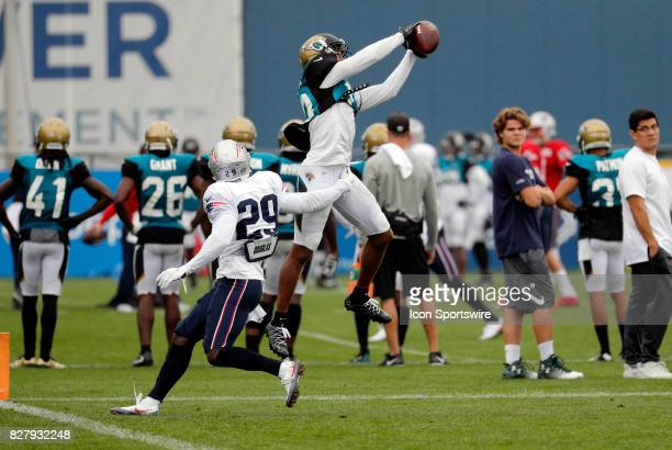 Jacksonville Jaguars wide receiver Rashad Greene Sr makes a grab over New England Patriots defensive back DJ Killings during a joint New England...