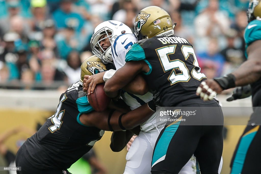 Jacksonville Jaguarslinebacker Myles Jack (44) and Jacksonville Jaguars linebacker Blair Brown (53) tackle Indianapolis Colts quarterback Jacoby Brissett (7) during the game between the Indianapolis Colts and the Jacksonville Jaguars on December 3, 2017 at EverBank Field in Jacksonville, Fl.