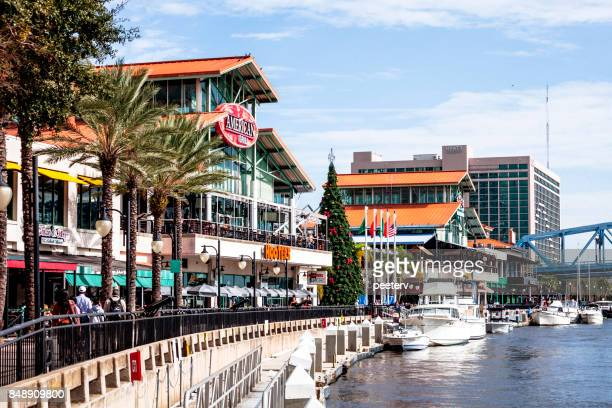 jacksonville landing on riverbank - jacksonville, florida - jacksonville florida stock pictures, royalty-free photos & images