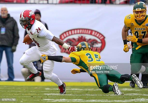 Jacksonville State RB Troymaine Pope tries to get past North Dakota State strong safety Robbie Grimsley during the game between the North Dakota...