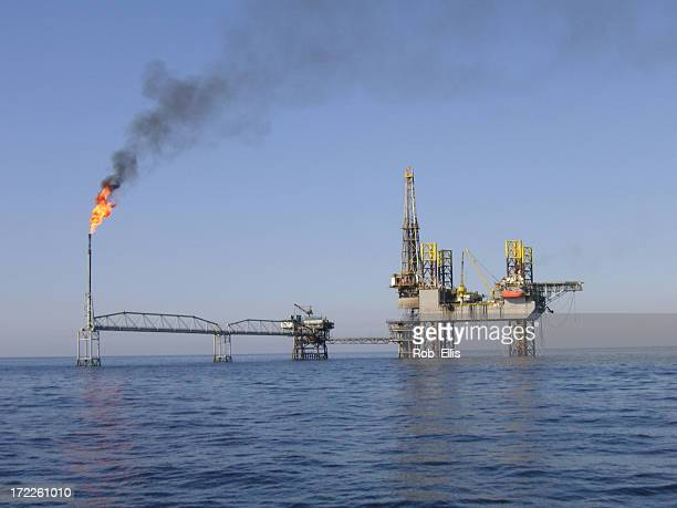 jackup over a producing platform - iran stock pictures, royalty-free photos & images