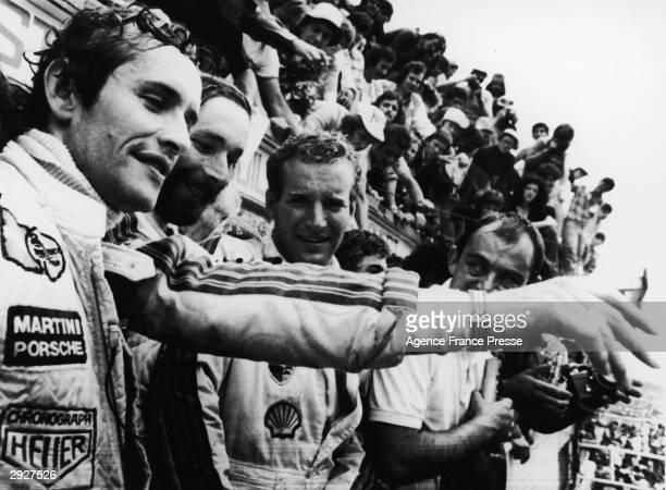 Jacky Ickx Jurgen Barth and Hurley Haywood celebrate after winning the 24 Hour Le Mans auto race France June 12 1977