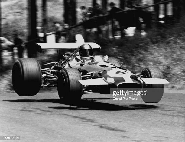 Jacky Ickx of Belgium driving the Motor Racing Developments Brabham BT26A Ford V8 gets airborne through the Pflantzgarten during the German Grand...