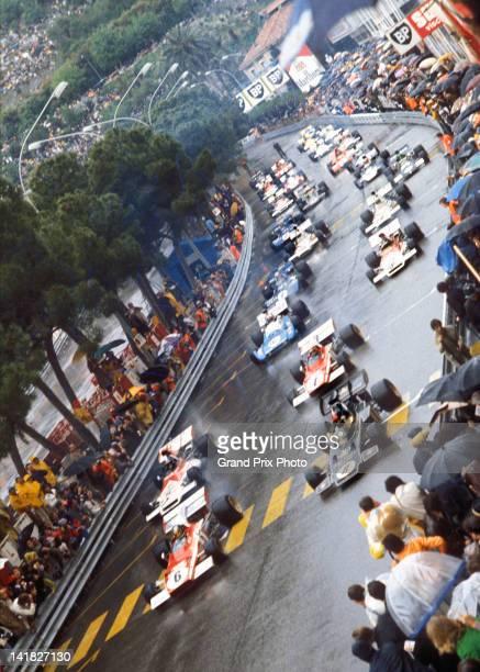 Jacky Ickx of Belgium in the Scuderia Ferrari 312B2 Ferrari F12 in pole position alongside Emerson Fittipaldi of Brazil driving the the John Player...