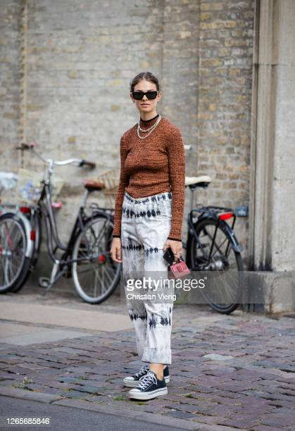 Jacky is seen wearing brown sweater, pants with print, micro Boyy bag outside Selected during Copenhagen Fashion Week Spring/Summer 2021 on August...