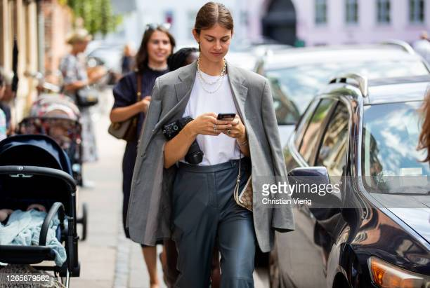 Jacky is seen wearing grey blazer outside Skall Studio during Copenhagen Fashion Week Spring/Summer 2021 on August 12, 2020 in Copenhagen, Denmark.