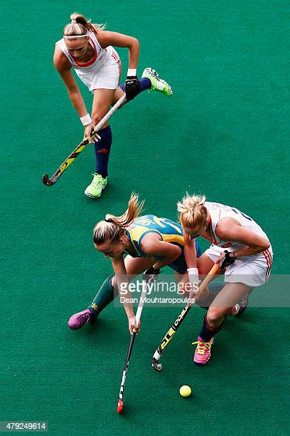 Jacky Schoenaker and Margot Van Geffen of the Netherlands battle for the ball with Emily Smith of Australia during the Fintro Hockey World League...