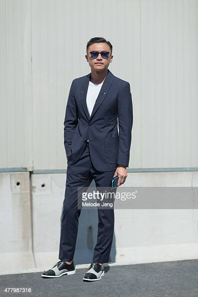 Jacky Tam of GQ China wears a Ports 1961 suit during Milan Men's Fashion Week Spring/Summer 2016 on June 20 2015 in Milan Italy