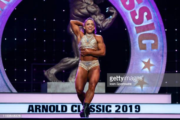 Jaclyn Baker competes in Fitness International as part of the Arnold Sports Festival on March 1 at the Greater Columbus Convention Center in Columbus...
