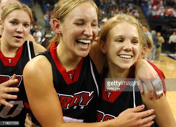 Jaclyn Blied and Trisha Goddard of Troy celebrate 5146 victory over Carondelet in the Division II girls final in the CIF State Basketball...