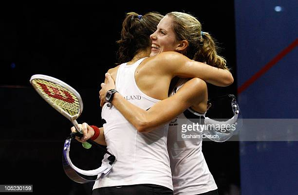 Jaclyn Hawkes and Joelle King of New Zealand embrace after defeating Jenny Duncalf and Laura Massaro of England to win the gold medal in the womens...