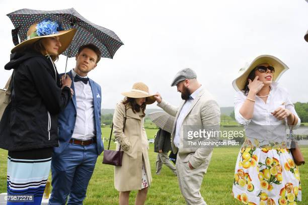 Jaclyn Mohlmann left to right Nick Havrilak Carly Crane Dustin Burton and Caren Welker gather to watch the Virginia Gold Cup Races at Great Meadow on...