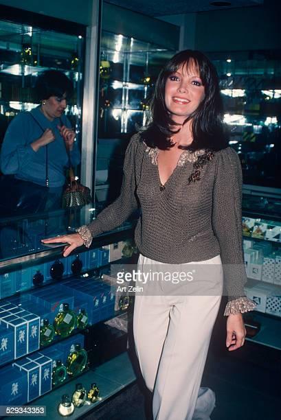 Jaclyn Smith at a perfume counter circa 1970 New York