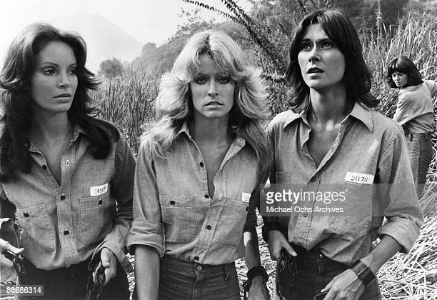 R Jaclyn Smith Farrah Fawcett and Kate Jackson dressed as prisoners on the set of Charlie's Angels circa 1977 in Los Angeles California