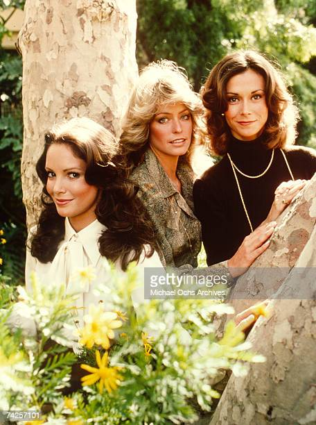 R Jaclyn Smith Farrah Fawcett and Kate Jackson pose for a portrait on the set of Charlie's Angels circa 1977 in Los Angeles California