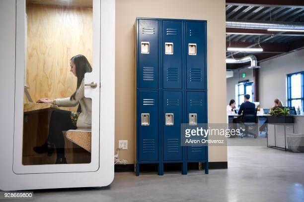 Jaclyn Willis works in one of the many private phone booths during a day in the office at Velocity Global on Tuesday March 6 2018