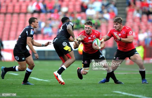 Jaco Kriel and Malcolm Marx of Lions in action with Lukhanyo Am and Curwin Bosch of Sharks during the Super Rugby Quarter final between Emirates...
