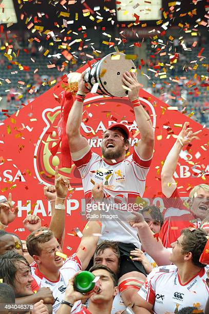 Jaco Kriel of the Lions celebrates with the trophy during the Absa Currie Cup Final match between Xerox Golden Lions and DHL Western Province at...