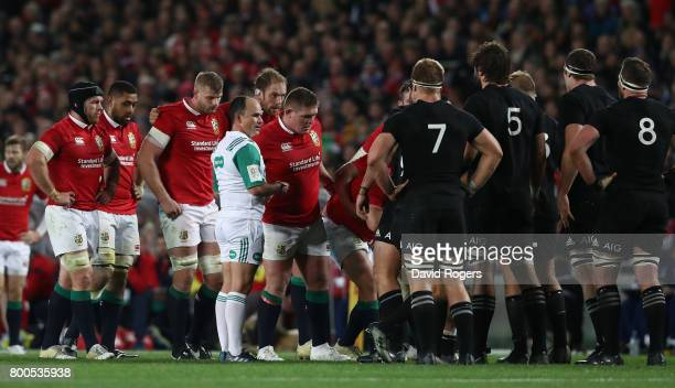 Jaco Peyper the referee talks to the packs during the Test match between the New Zealand All Blacks and the British Irish Lions at Eden Park on June...