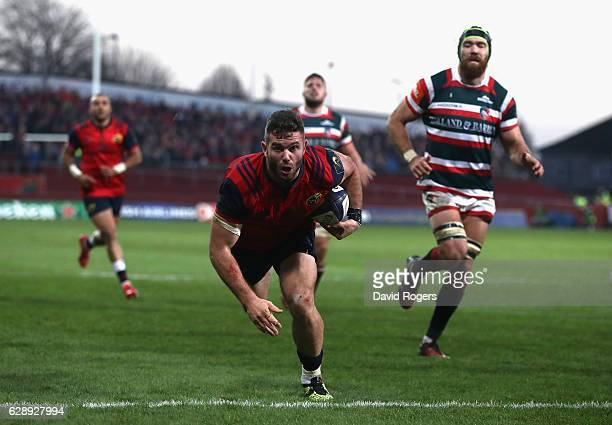 Jaco Taute of Munster dives in for a try during the European Champions Cup match between Munster and Leicester Tigers at Thomond Park on December 10,...