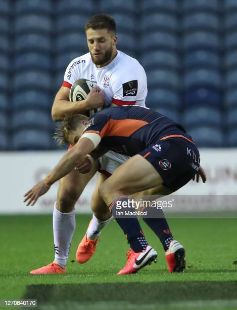 Jaco van der Walt of Edinburgh Rugby tackles Stuart McCloskey of Ulster during the Guinness PRO14 PlayOff Semi Final between Edinburgh and Ulster at...